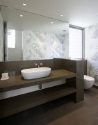 Example of Caesarstone Bathroom Vanity; Wall mount faucet; above mount vessel sink